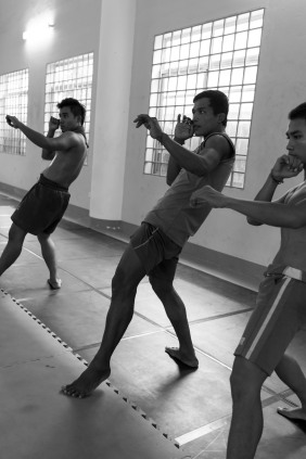 CAMBODIA. Phnom Penh. 20/02/2014: Manou Phuon, Choreographer, rehearsing a new piece inspired by khmer boxing with Amrita Performing Arts dancers, here coached by Him Saran, a professional boxer.